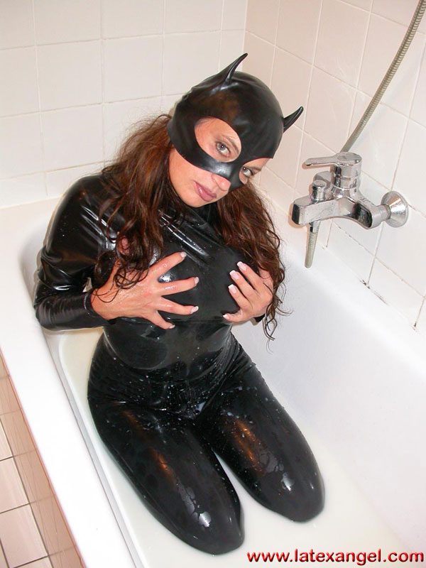 Milk bath.  I take a bath in milk, wearing a catmask and a black latex catsuit.I open my crotchand spread my huge pussylips.