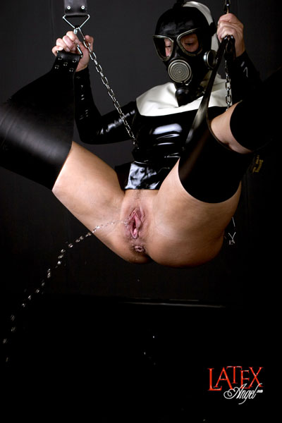 Pissing in latex on swing