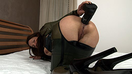 Wearing a latex XXX while fucking ass with dildo